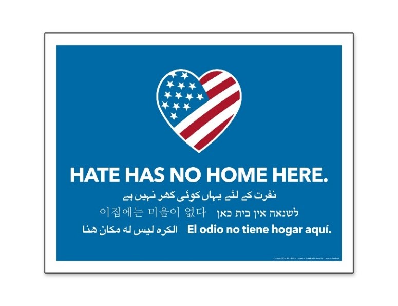 "American flag inside of a heart shape with a blue background and ""Hate has no home here"""